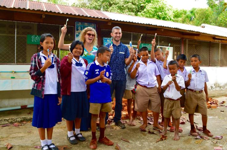 Carolyn and Cody volunteer assist in dental project thailand